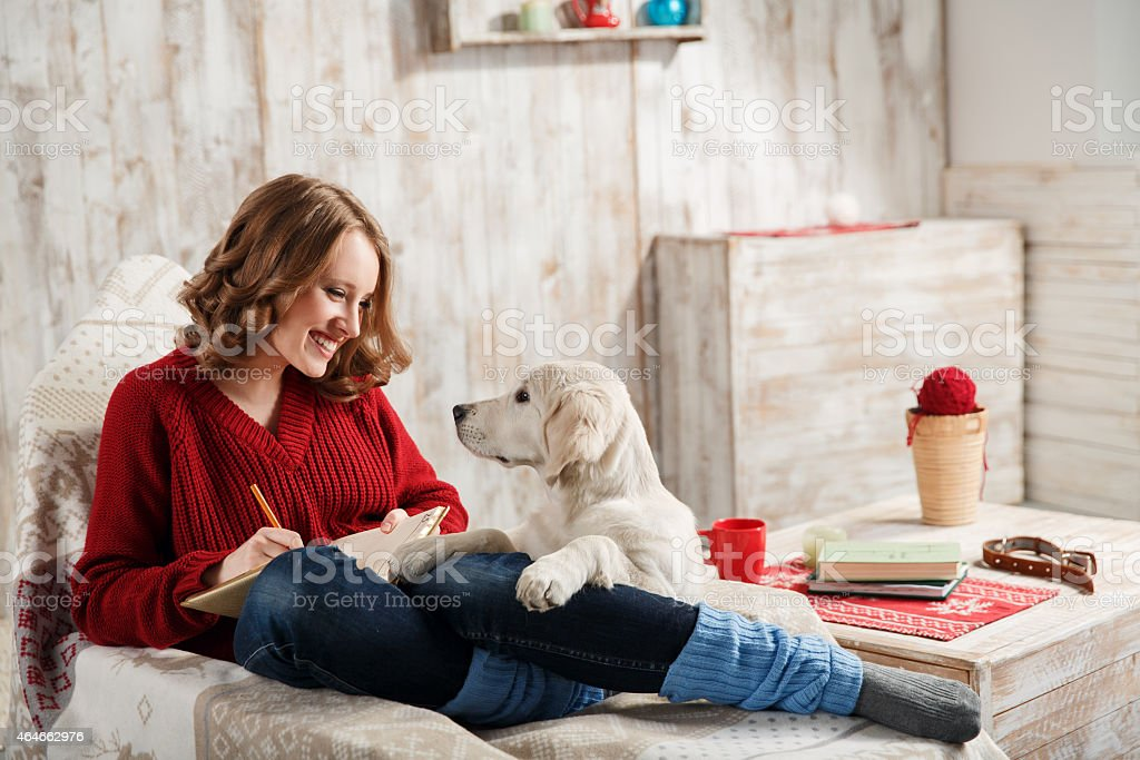 A woman with her pet dog at home stock photo