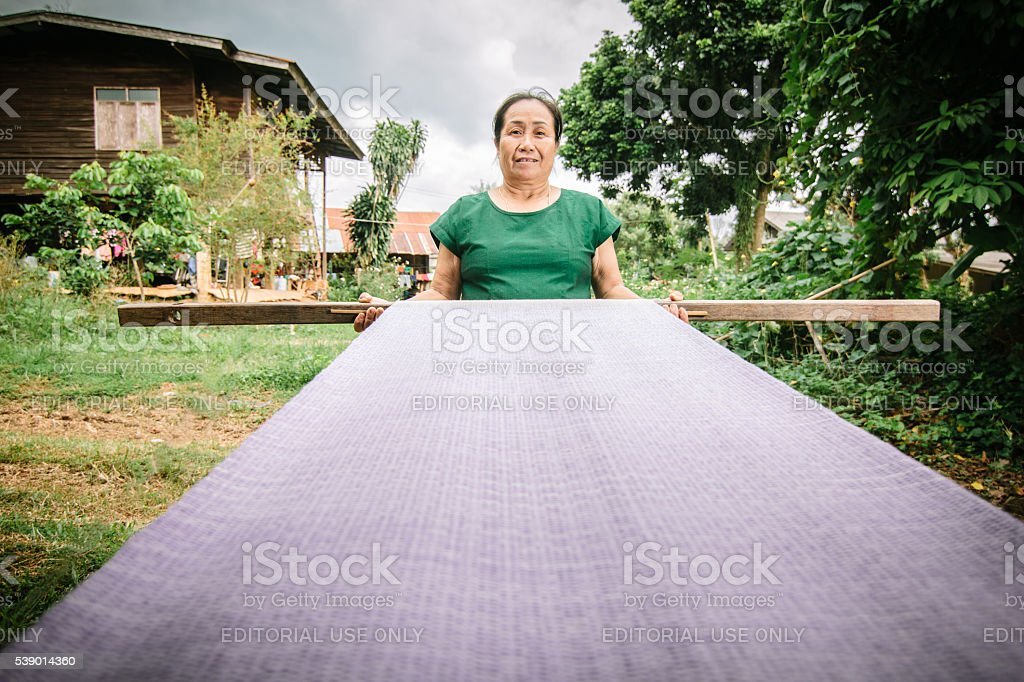 Woman with her textiles. stock photo