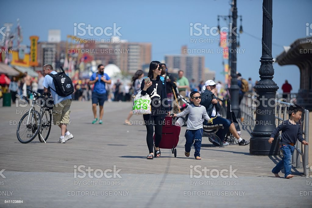 Woman with her two children on the Coney Island Boardwalk stock photo