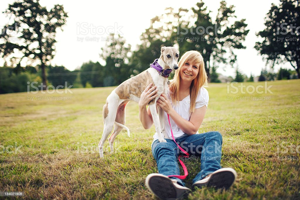 Woman With Her Whippet Dog stock photo