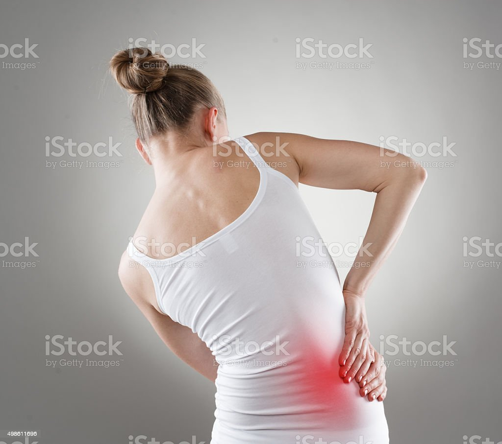 Woman with hip pain stock photo