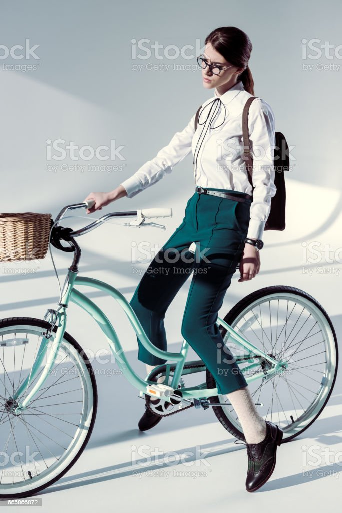 woman with hipster bicycle stock photo
