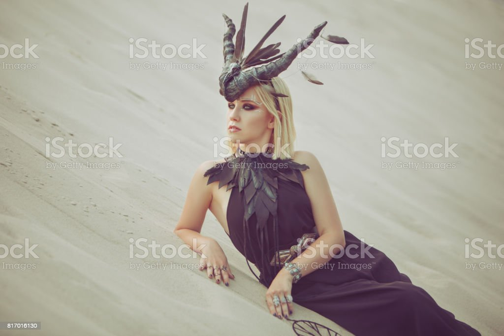 Woman with horns on her head. stock photo