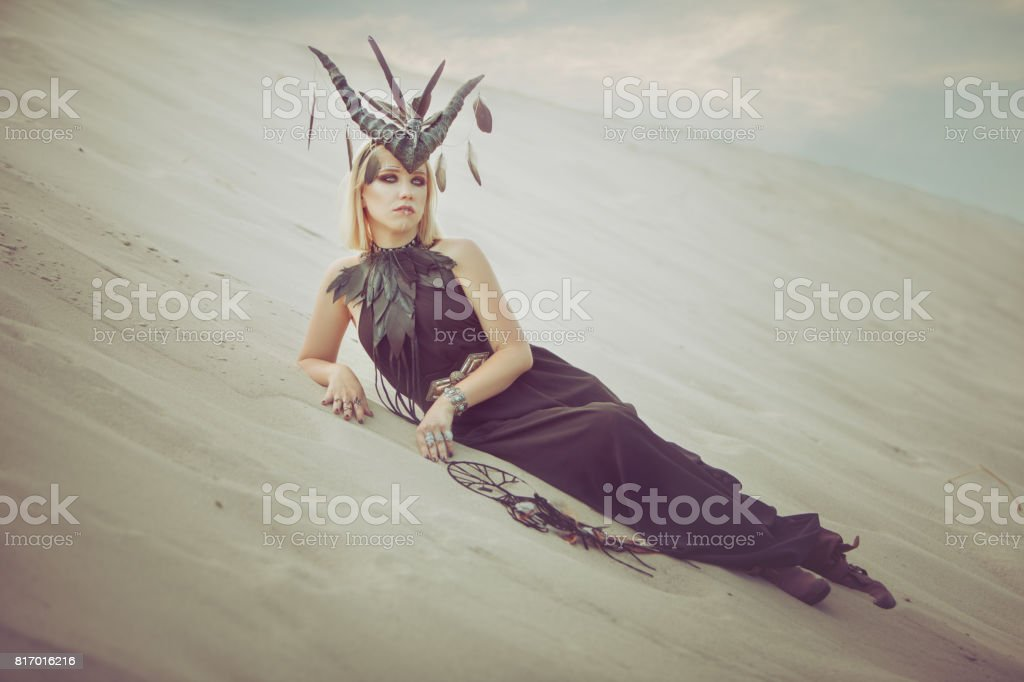 Woman with horns. stock photo