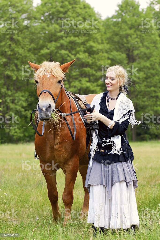 Woman with horse royalty-free stock photo