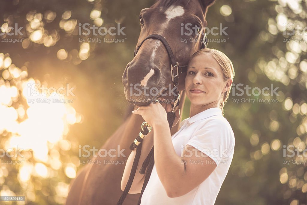 Woman with horse stock photo