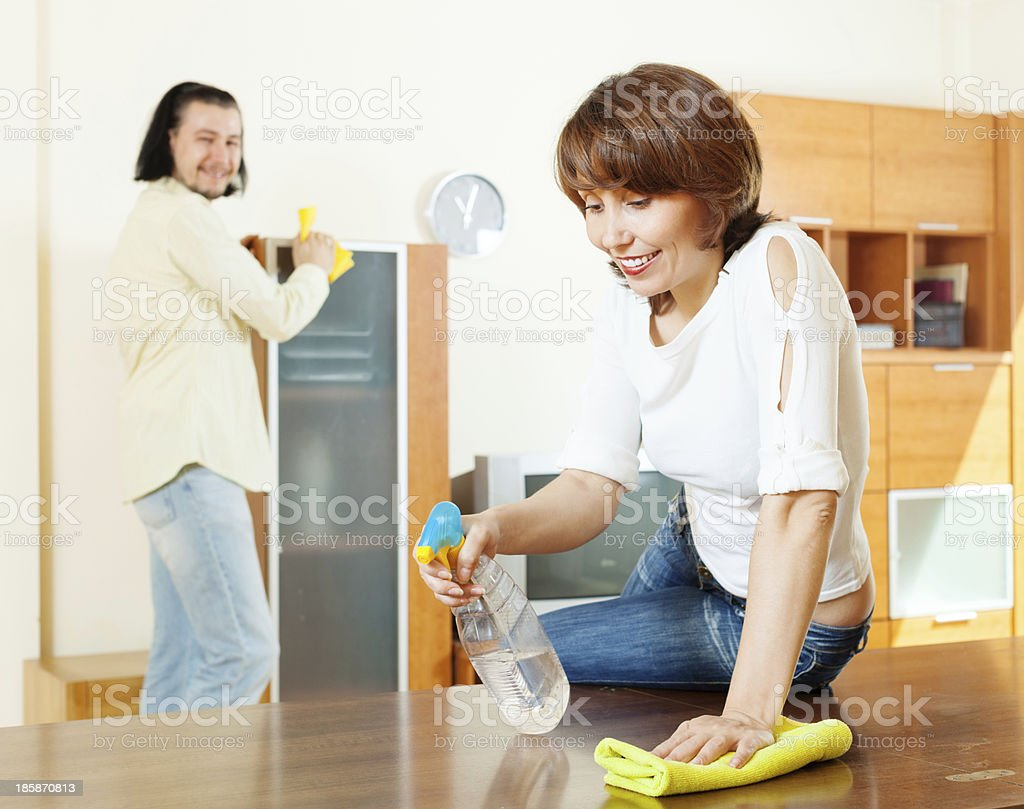 woman with husband cleaning  at home royalty-free stock photo
