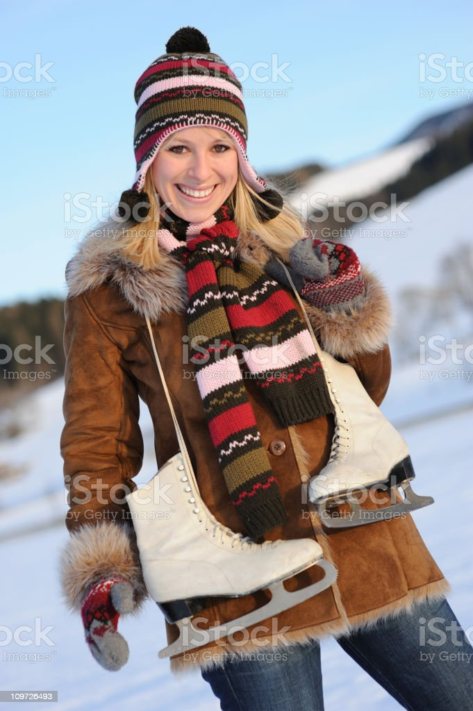 Woman with Ice Skates royalty-free stock photo