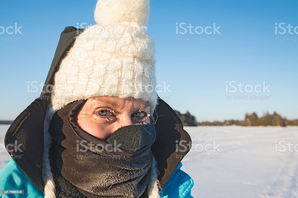 Woman with icicles on eyelashes in Minnesota stock photo
