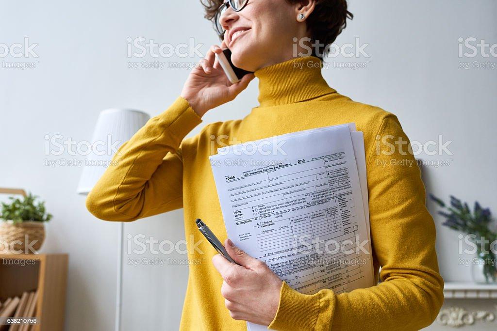 Woman with individual tax return stock photo
