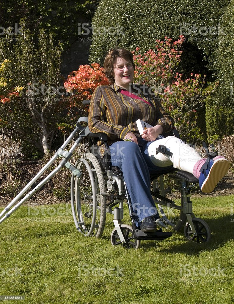 Woman with injured leg in wheelchair royalty-free stock photo