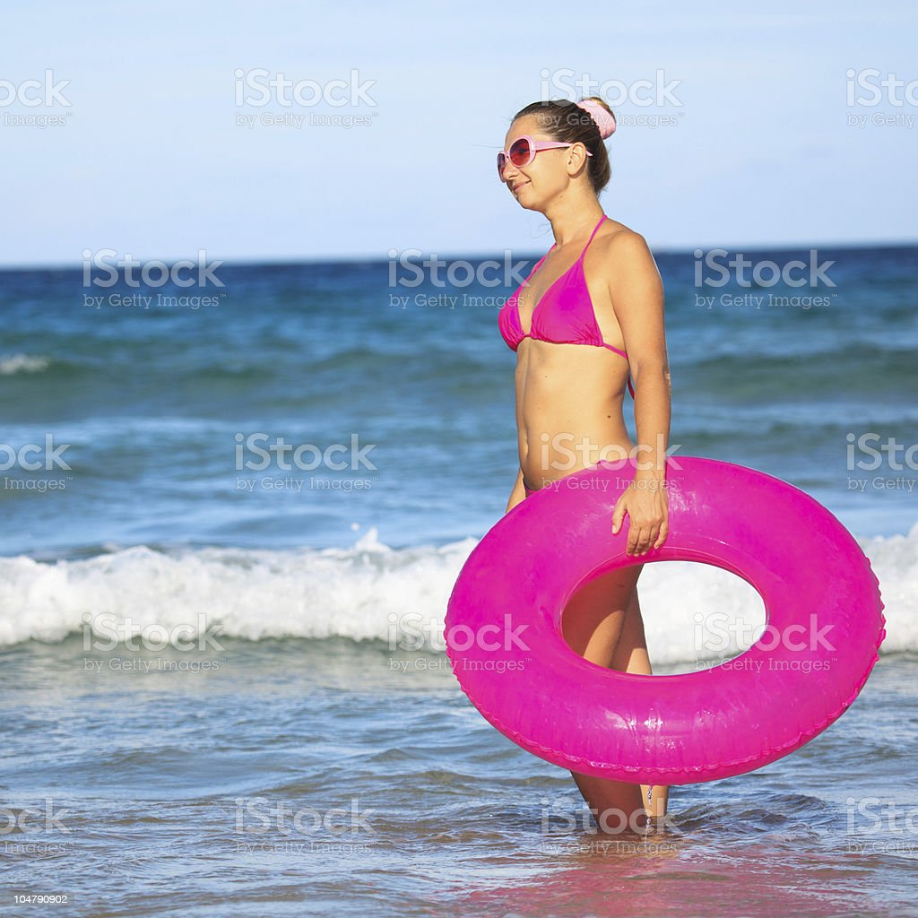 Woman with inner tube royalty-free stock photo