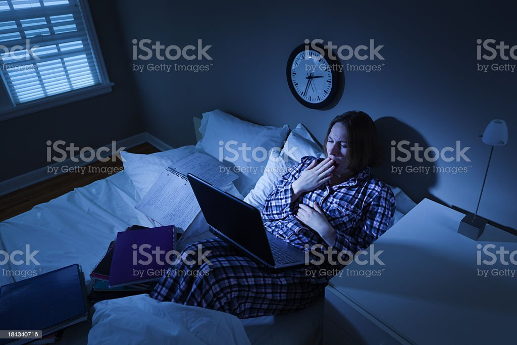 Woman with Insomnia, College Student in Bed Working on Computer stock photo