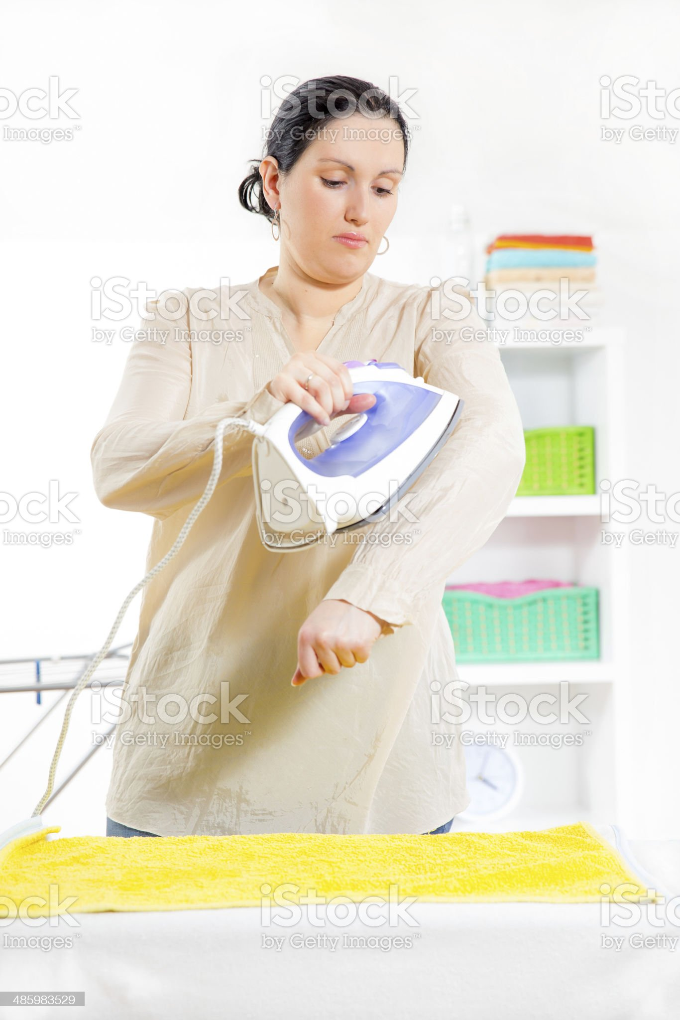 Woman with iron royalty-free stock photo