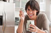 Woman with jar of cash