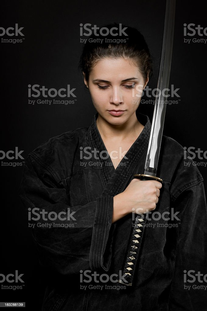Woman with katana, black background royalty-free stock photo
