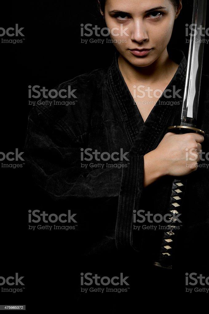 Woman with katana stock photo