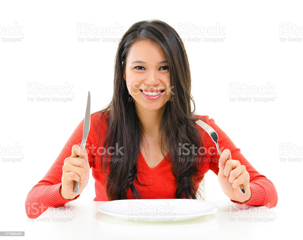 A woman with knife and fork ready to dine stock photo
