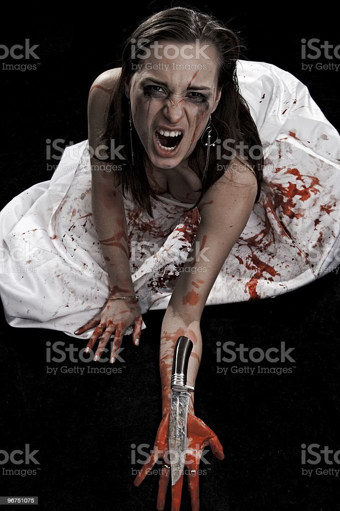 woman with knife royalty-free stock photo