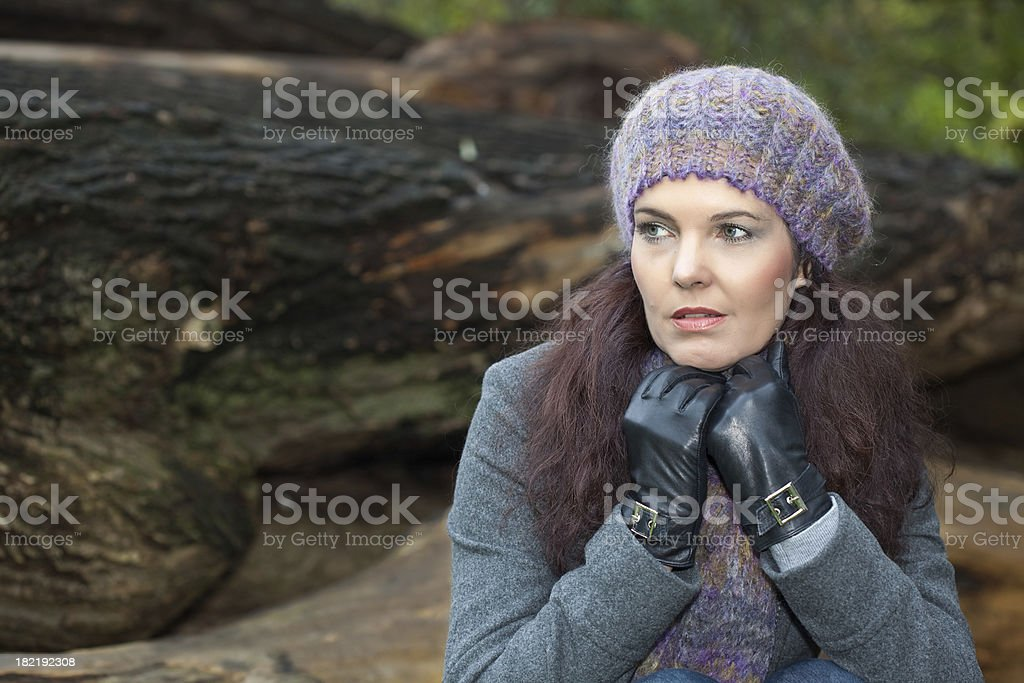 Woman with knitted cap and gloves stock photo