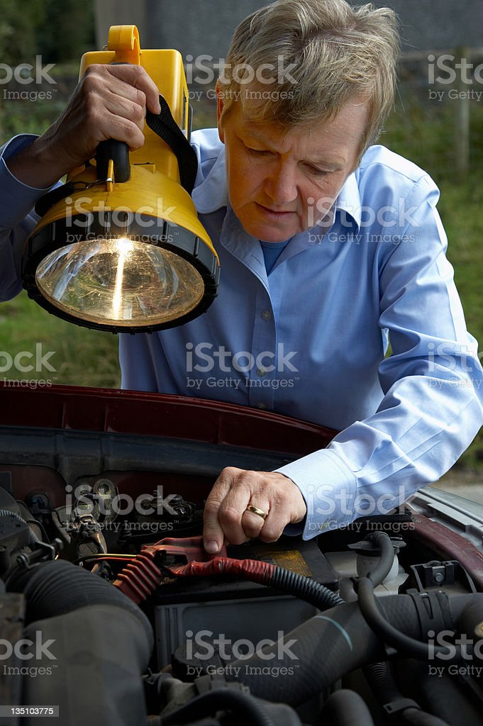 woman with lamp and broken down SUV royalty-free stock photo