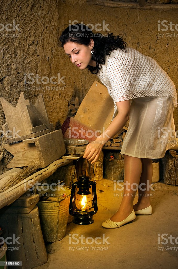 Woman with lamp in the cellar royalty-free stock photo