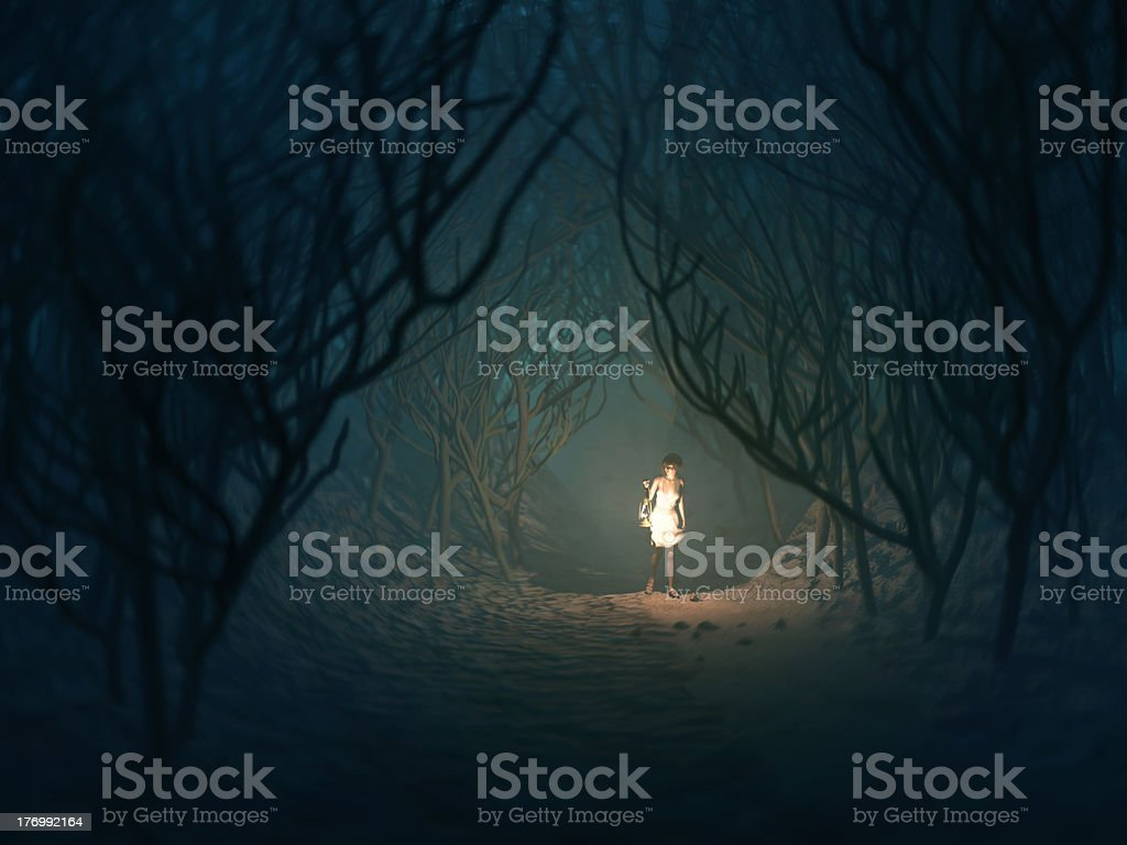 woman with lamp in the dark forest stock photo