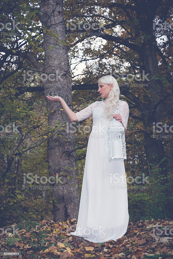 woman with lantern and glass ball stock photo