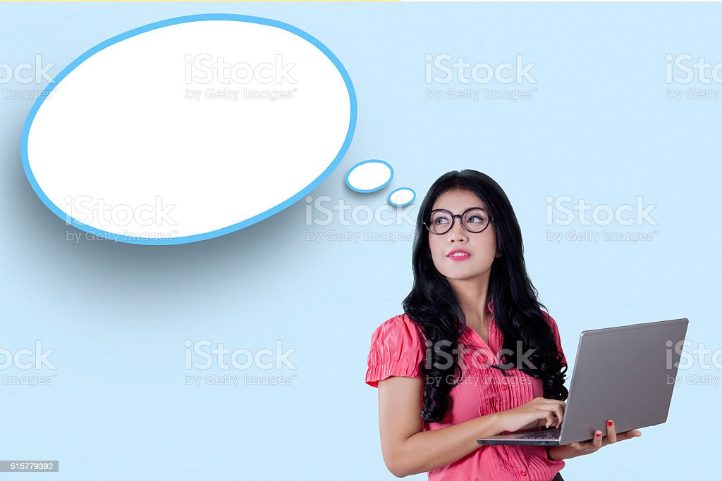 Woman with laptop and cloud bubbles stock photo