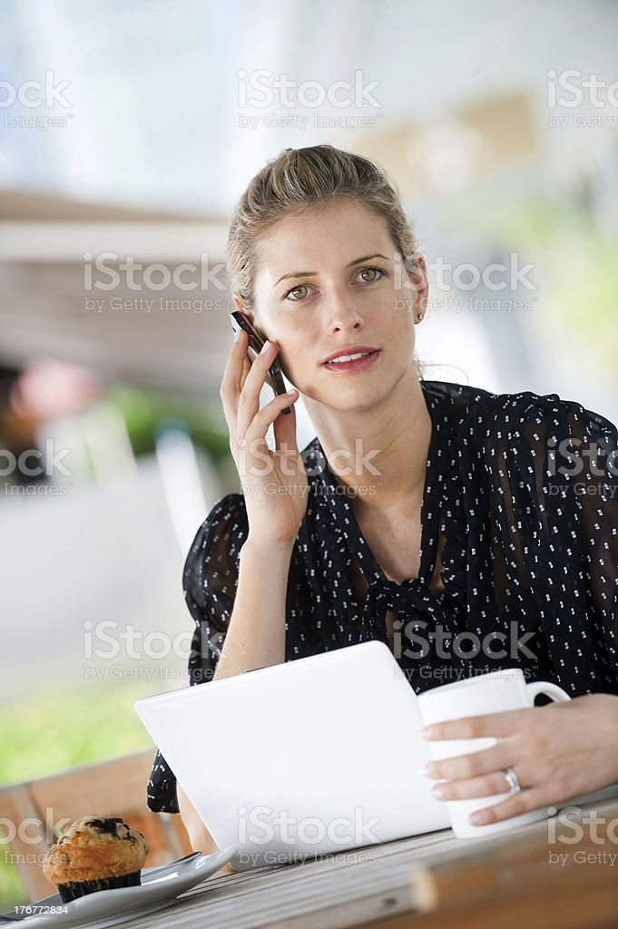 Woman With Laptop and Phone royalty-free stock photo