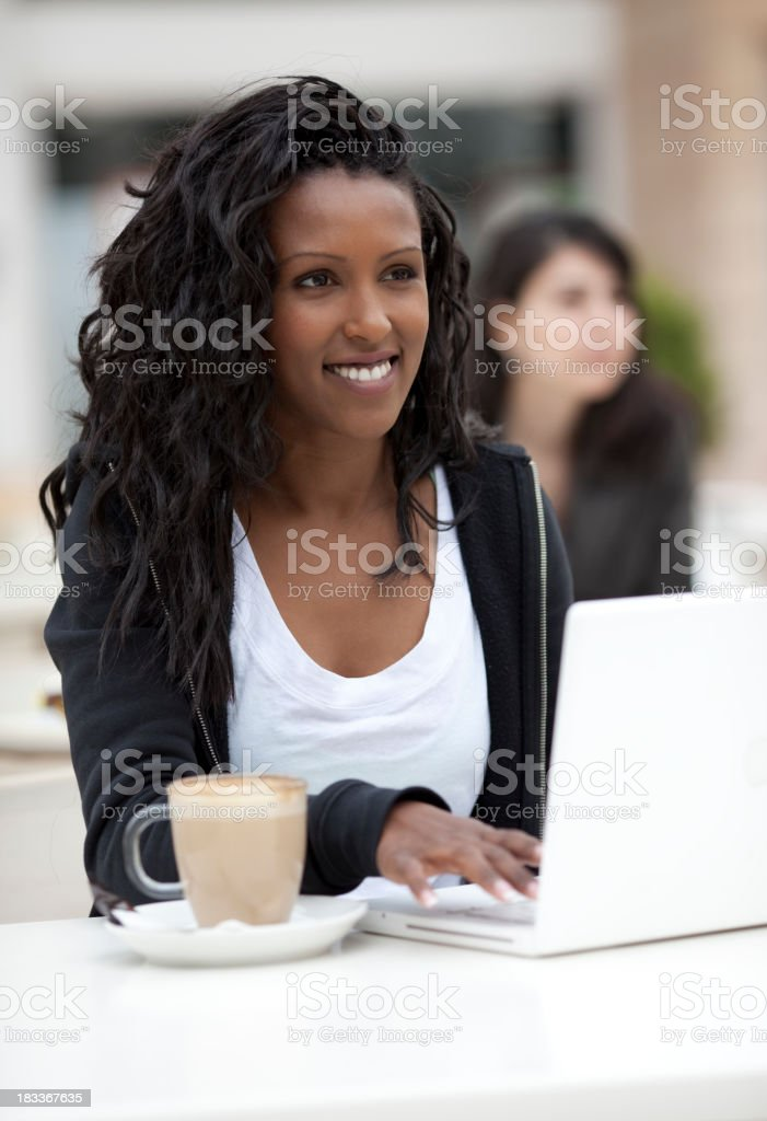 Woman with laptop at cafe. royalty-free stock photo