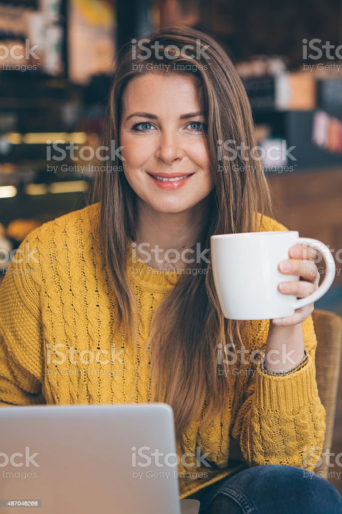 Woman with laptop at cafe. stock photo