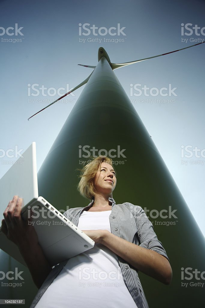 Woman with Laptop at Wind Turbine royalty-free stock photo