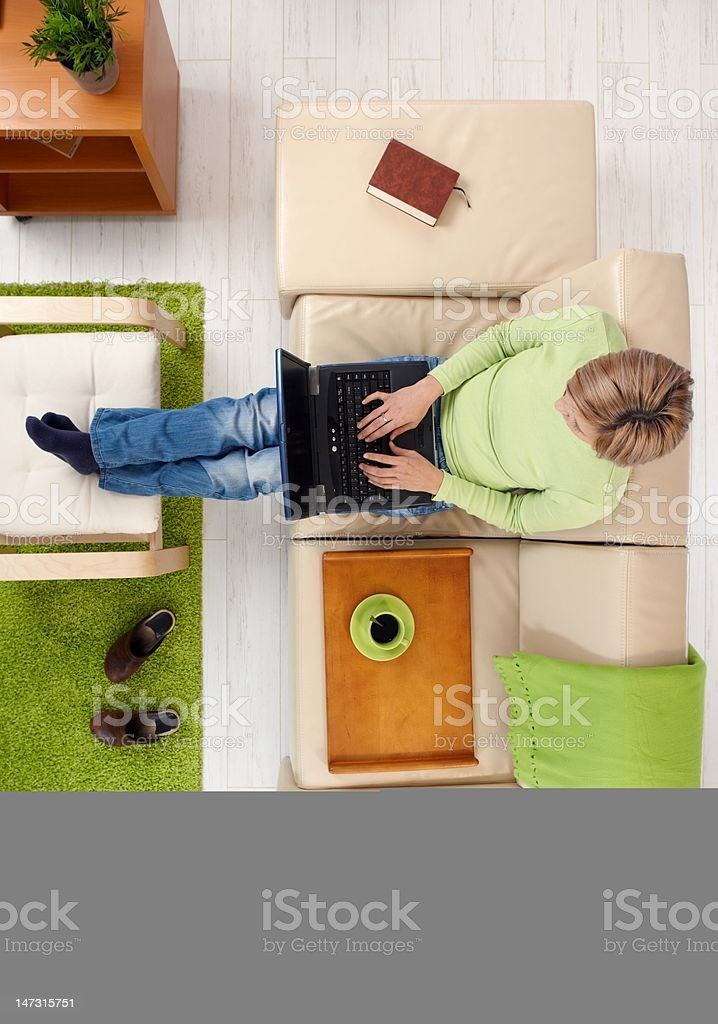 Woman with laptop from above royalty-free stock photo