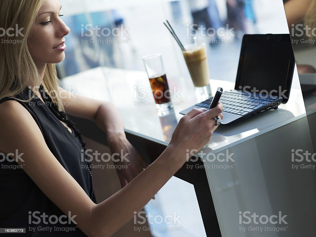 Woman with Laptop in cafe royalty-free stock photo