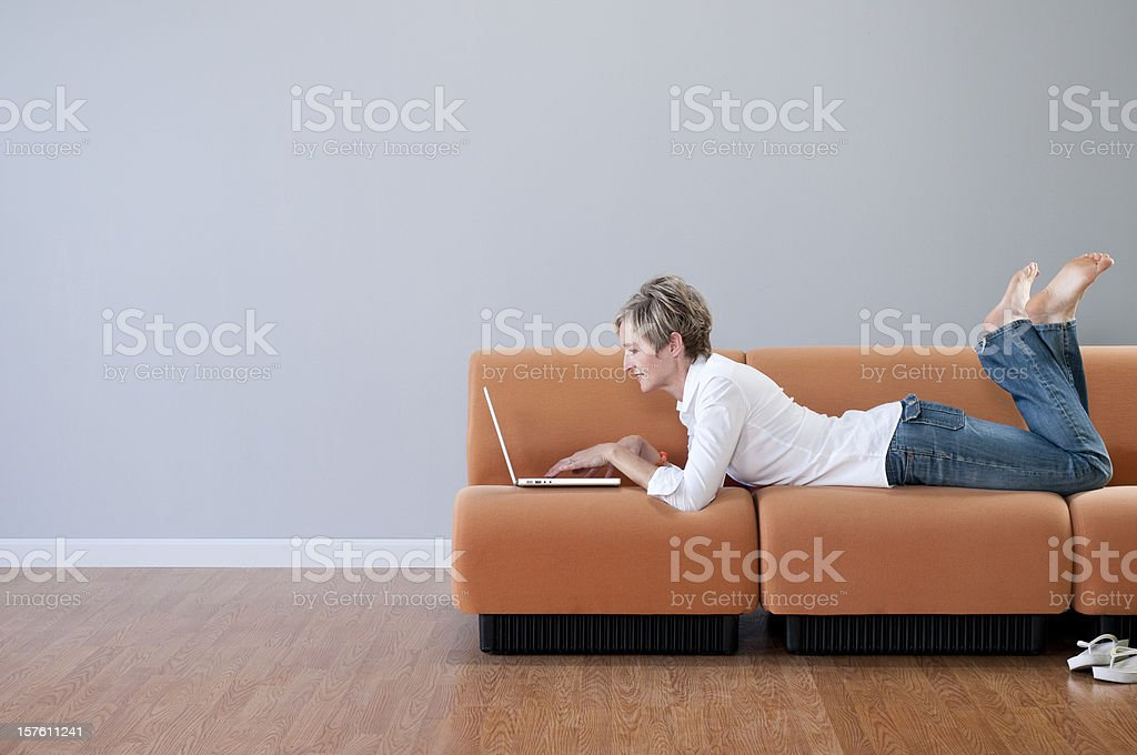 Woman With Laptop In Empty Room royalty-free stock photo