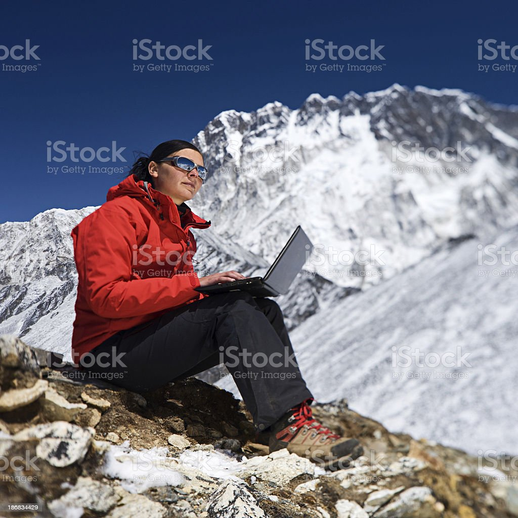 Woman with laptop in Mount Everest National Park royalty-free stock photo