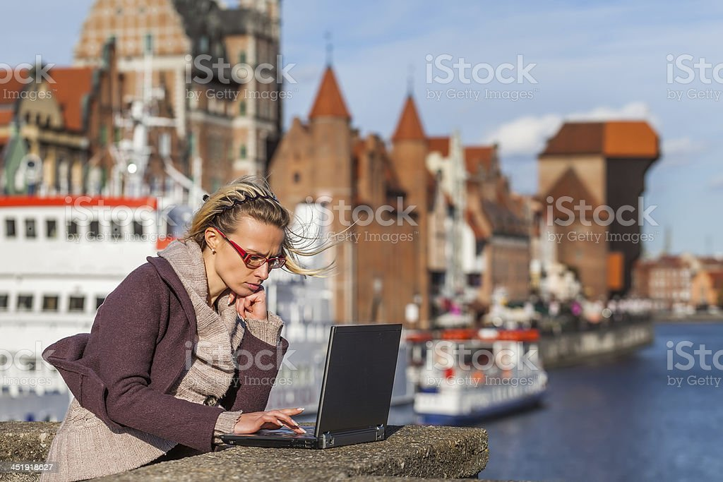 Woman with laptop on the bridge royalty-free stock photo