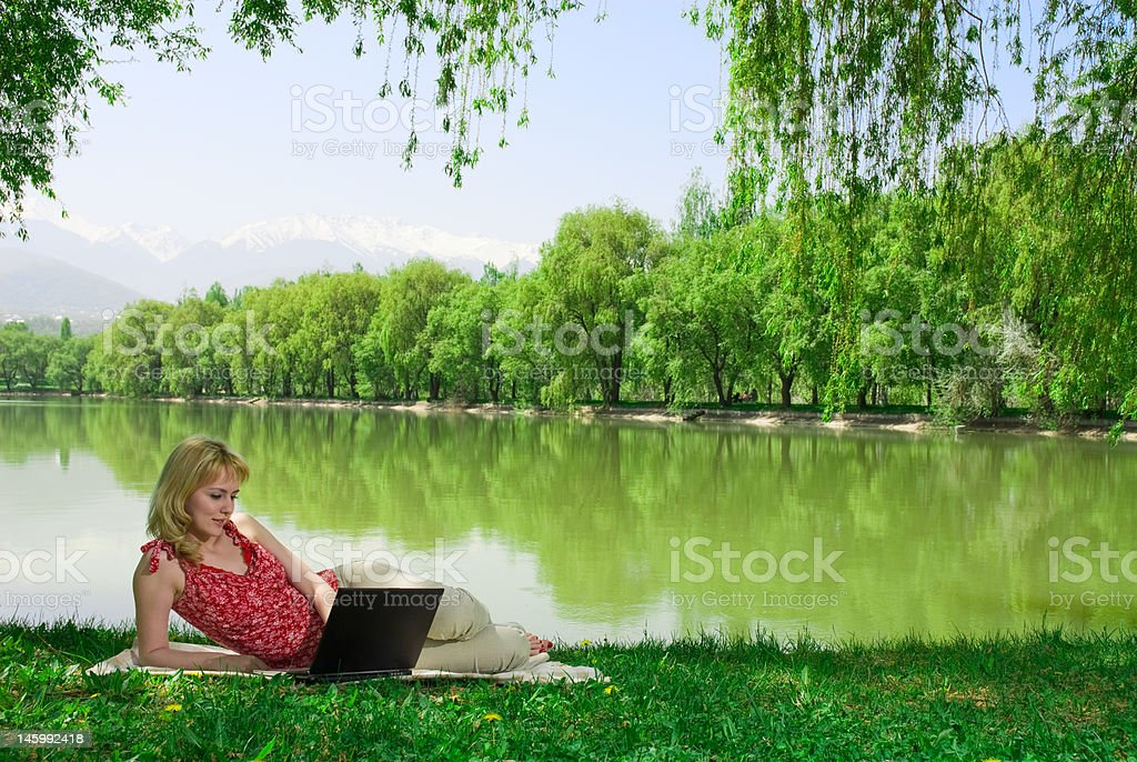 Woman with laptop outdoors royalty-free stock photo