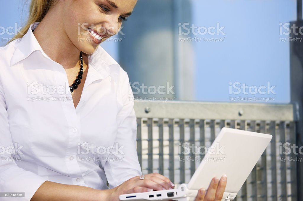 woman with laptop stock photo