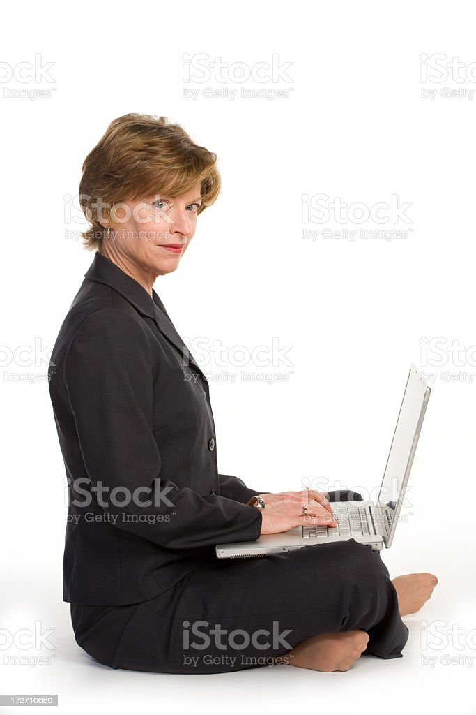 Woman with Laptop sits on the floor royalty-free stock photo