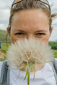 Woman with Large Dandelion
