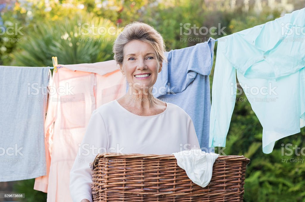 Woman with laundry basket stock photo