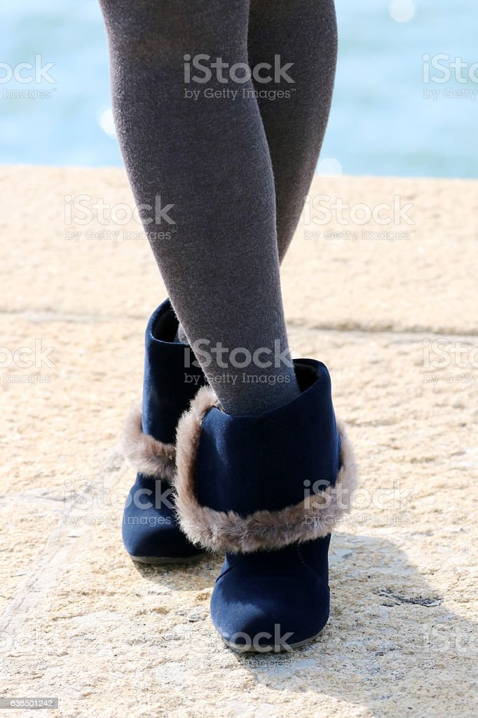 Woman with legs in stockings and boots stock photo