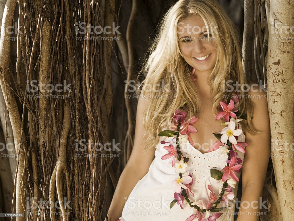 Woman with Lei Standing by a Banyan Tree royalty-free stock photo