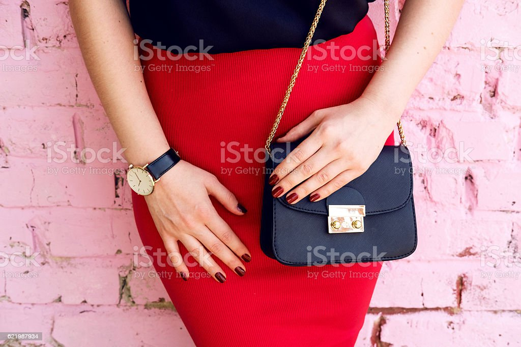 woman with little black bag in stylish outfit stock photo