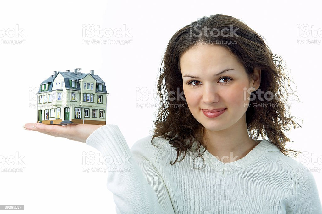 woman with little house on hand royalty-free stock photo
