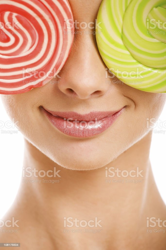 woman with lollipops covering eyes royalty-free stock photo
