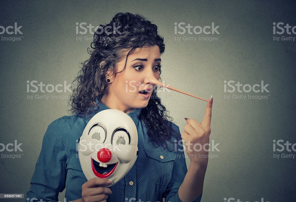 Woman with long nose clown mask. Liar concept stock photo