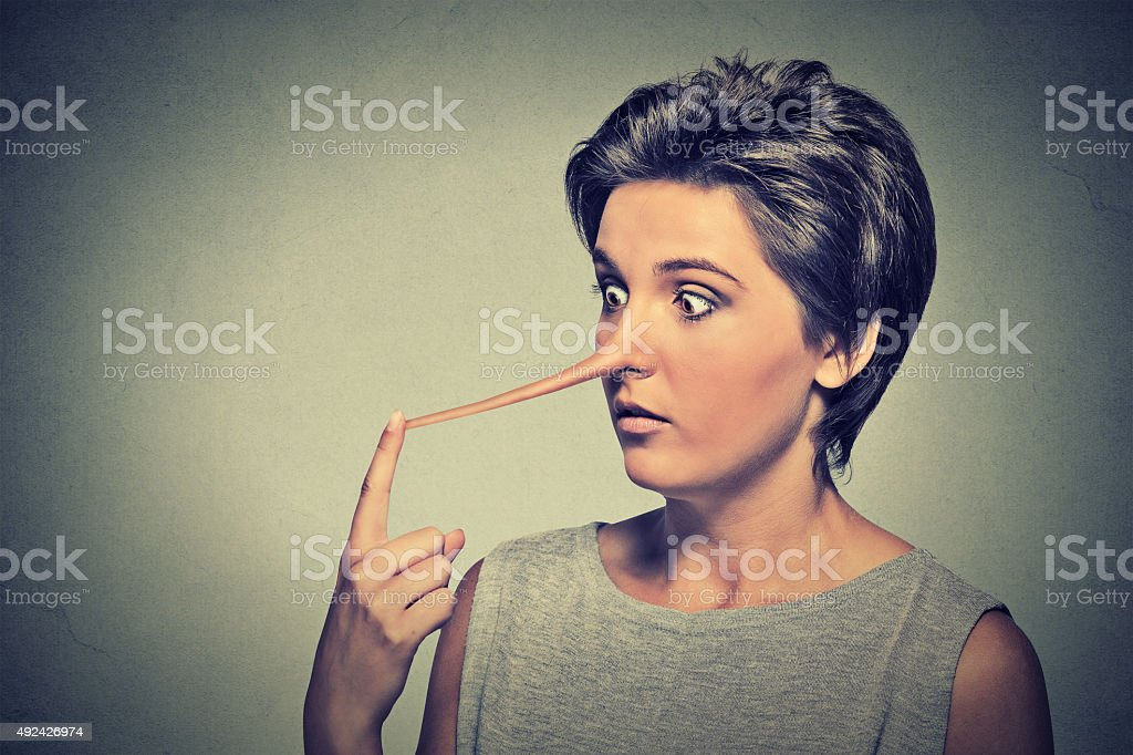 Woman with long nose. Liar concept stock photo